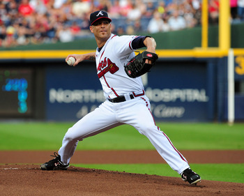 ATLANTA - JULY 30: Tim Hudson #15 of the Atlanta Braves pitches against the Florida Marlins at Turner Field on July 30, 2011 in Atlanta, Georgia. (Photo by Scott Cunningham/Getty Images)