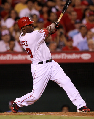ANAHEIM, CA - AUGUST 03:  Torii Hunter #48 of the Los Angeles Angels of Anaheim hits a to run single in the third inning against the Minnesota Twins on August 3, 2011 at Angel Stadium in Anaheim, California.  (Photo by Stephen Dunn/Getty Images)
