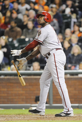 SAN FRANCISCO, CA - AUGUST 2: Justin Upton #10 of the Arizona Diamondbacks tosses his bat and watches the flight of his ball sail over the fence for a two-run home run against the San Francisco Giants in the eighth inning  during an MLB baseball game at A