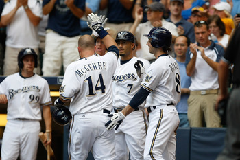 MILWAUKEE, WI - AUGUST 03: Casey McGehee #14 of the Milwaukee Brewers is congratulated by teammates Ryan Braun #8 and Felipe Lopez #7 after hitting a home run against the St. Louis Cardinals at Miller Park on August 3, 2011 in Milwaukee, Wisconsin. (Photo