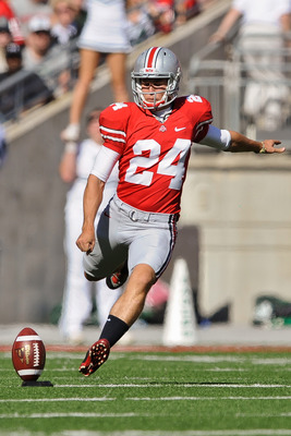 COLUMBUS, OH - SEPTEMBER 25:  Drew Basil #24 of the Ohio State Buckeyes kicks off against the Eastern Michigan Eagles at Ohio Stadium on September 25, 2010 in Columbus, Ohio.  Ohio State won 73-20. (Photo by Jamie Sabau/Getty Images)
