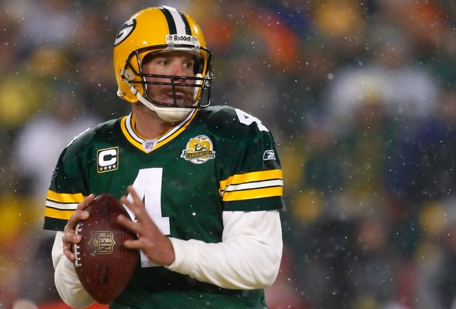GREEN BAY, WI - JANUARY 12:  Quarterback Brett Favre #4 of the Green Bay Packers prepares to throw the ball against the Seattle Seahawks during the NFC divisional playoff game on January 12, 2008 at Lambeau Field in Green Bay, Wisconsin. The Packers defea