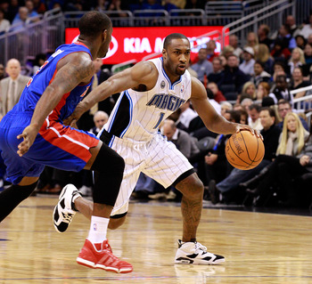 ORLANDO, FL - JANUARY 24:  Gilbert Arenas #1 of the Orlando Magic drives against Rodney Stuckey #3 of the Detroit Pistons during the game at Amway Arena on January 24, 2011 in Orlando, Florida.  NOTE TO USER: User expressly acknowledges and agrees that, b