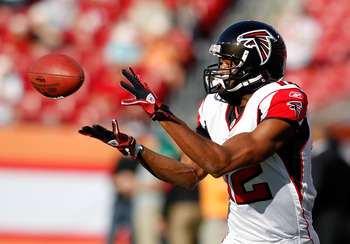 TAMPA, FL - DECEMBER 05:  Receiver Michael Jenkins #12 of the Atlanta Falcons catches a pass during warmups against the Tampa Bay Buccaneers at Raymond James Stadium on December 5, 2010 in Tampa, Florida.  (Photo by J. Meric/Getty Images)