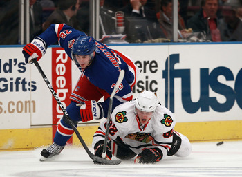 NEW YORK - NOVEMBER 01:  Tomas Kopecky #82 of the Chicago Blackhawks and Erik Christensen #26 of the New York Rangers battle for the puck at Madison Square Garden on November 1, 2010 in New York City.  (Photo by Bruce Bennett/Getty Images)