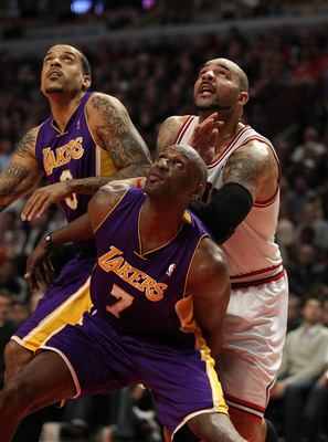 CHICAGO, IL - DECEMBER 10: Lamar Odom #7 and Matt Barnes #9 of the Los Angeles Lakers move for a rebound against Carlos Boozer #5 of the Chicago Bulls at the United Center on December 10, 2010 in Chicago, Illinois. The Bulls defeated the Lakers 88-84. NOT