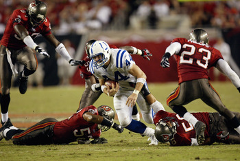 TAMPA, FL - OCTOBER 6:  Tight end Dallas Clark #44 of the Indianapolis Colts dives for more yards as Tampa Bay Buccaneers defensive players attempt to tackle him on October 6, 2003 at Raymond James Stadium in Tampa, Florida. The Colts defeated the Buccane