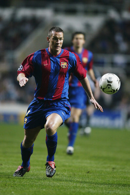 NEWCASTLE - MARCH 19:  Patrik Andersson of Barcelona chases the ball during the UEFA Champions League Group A match between Newcastle United and FC Barcelona held on March 19, 2003 at St James's Park in Newcastle, England.  Barcelona won the match 2-0.  (