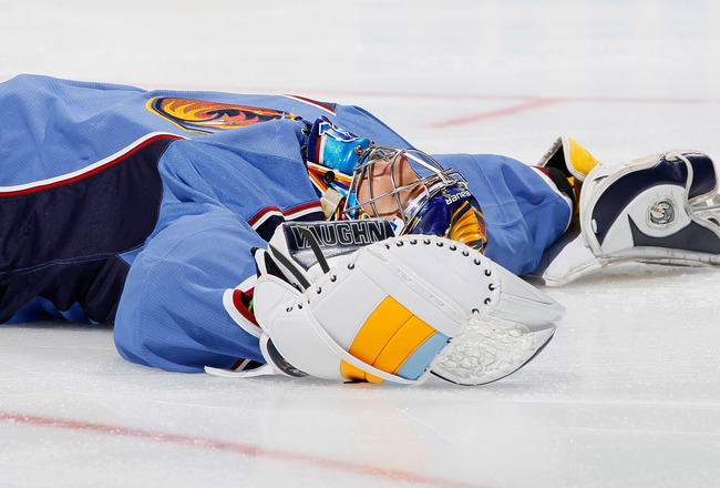 ATLANTA - OCTOBER 08:  Goaltender Ondrej Pavelec #31 of the Atlanta Thrashers lays on the ice after he fell backwards in the first few minutes of the first period against the Washington Capitals at Philips Arena on October 8, 2010 in Atlanta, Georgia.  (P
