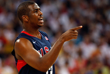 BEIJING - AUGUST 24:  Chris Paul #13 of the United States signals to teammates during the gold medal game against Spain during Day 16 of the Beijing 2008 Olympic Games at the Beijing Olympic Basketball Gymnasium on August 24, 2008 in Beijing, China.  (Pho