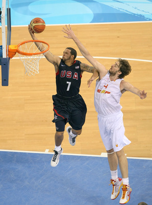 BEIJING - AUGUST 24:  Deron Williams #7 of the United States lays the ball up past Pau Gasol #13 of Spain in the gold medal game during Day 16 of the Beijing 2008 Olympic Games at the Beijing Olympic Basketball Gymnasium on August 24, 2008 in Beijing, Chi