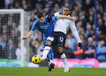 LONDON, ENGLAND - DECEMBER 28: Wilson Palacios of Tottenham Hotspur challenges Joey Barton of Newcastle United during the Barclays Premier League match between Tottenham Hotspur and Newcastle United at White Hart Lane on December 28, 2010 in London, Engla