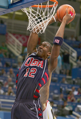 ATHENS - AUGUST 26:   Amare Stoudemire #12 of United States slam dunks against Spain in the first half of the men's basketball quarterfinal game on August 26, 2004 during the Athens 2004 Summer Olympic Games at the Indoor Hall of the Olympic Sports Comple