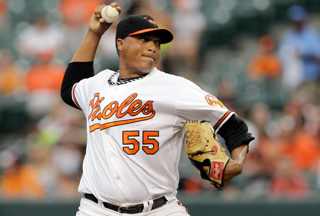 BALTIMORE, MD - JULY 22:  Starting pitcher Alfredo Simon #55 of the Baltimore Orioles delivers to a Los Angeles Angels of Anaheim batter during the first inning at Oriole Park at Camden Yards on July 22, 2011 in Baltimore, Maryland.  (Photo by Rob Carr/Ge
