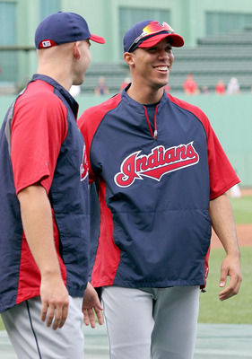 BOSTON, MA - AUGUST 3:  Ubaldo Jimenez of the Cleveland Indians chats with new teammate Justin Masterson #63 before a game with the Cleveland Indians at Fenway Park on August 3, 2011 in Boston, Massachusetts.  (Photo by Jim Rogash/Getty Images)