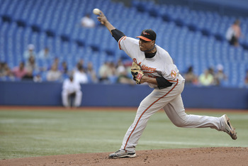 TORONTO, CANADA - JULY 27:  Alfredo Simon #55 of the Baltimore Orioles delivers a pitch during MLB game action against the Toronto Blue Jays July 27, 2011 at Rogers Centre in Toronto, Ontario, Canada. (Photo by Brad White/Getty Images)