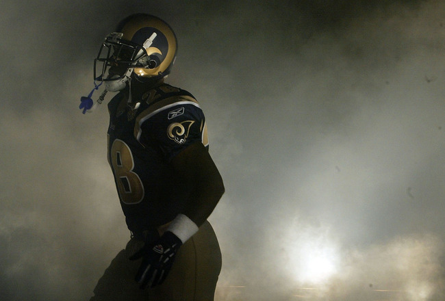 ST. LOUIS - OCTOBER 18:  Running back Marshall Faulk #28 of the St. Louis Rams runs through the smoke during pregame introductions before the Rams take on the Tampa Bay Buccaneers on October 18, 2004 at the Edward Jones Dome in St. Louis, Missouri.  (Phot