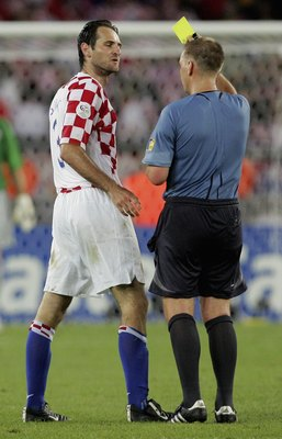 STUTTGART, GERMANY - JUNE 22:  Josip Simunic of Croatia is shown a yellow card by English referee Graham Poll during the FIFA World Cup Germany 2006 Group F match between Croatia and Australia at the Gottlieb-Daimler Stadium on June 22, 2006 in Stuttgart,