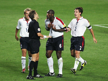 LISBON, PORTUGAL - JUNE 24:  Sol Campbell, Gary Neville and Phil Neville of England dispute the dissalowed goal during the UEFA Euro 2004, Quarter Final match between Portugal and England at the Luz Stadium on June 24, 2004 in Lisbon, Portugal. (Photo by