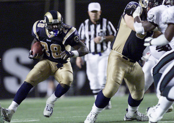 9 SEP 01: Marshall Faulk #28 of the St. Louis Rams charges down the field during the game against the Philadelphia Eagles at Veterans Stadium in Philadelphia, Pennsylvania. DIGITAL IMAGE.