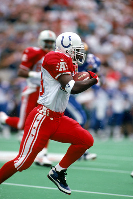 HONOLULU, HI - FEBRUARY 5:  Indianapolis Colts running back Marshall Faulk #28 of the AFC team runs with the ball during the 1995 NFL Pro Bowl at Aloha Stadium on February 5, 1995 in Honolulu, Hawaii.  The AFC defeated the NFC 41-13.  Marshall Faulk ran 1