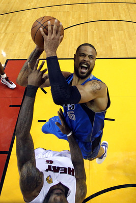 MIAMI, FL - JUNE 12:  Tyson Chandler #6 of the Dallas Mavericks attempts a shot againsbt LeBron James #6 of the Miami Heat in Game Six of the 2011 NBA Finals at American Airlines Arena on June 12, 2011 in Miami, Florida. The Mavericks won 105-95. NOTE TO