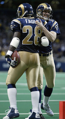 ST. LOUIS - NOVEMBER 30:  Jeff Wilkins #14 of the St. Louis Rams congratulates Marshall Faulk #28 after Faulk ran the ball in for a touchdown against the Minnesota Vikings on November 30, 2003 at the Edward Jones Dome in St. Louis, Missouri. The Rams defe