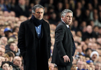 LONDON, ENGLAND - MARCH 16: Carlo Ancelotti, Manager of Chelsea looks on with Jose Mourinho, Coach of Inter Milan during the UEFA Champions League Round of 16 second leg match between Chelsea and Inter Milan at Stamford Bridge on March 16, 2010 in London,