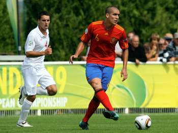 SAINT-LO, FRANCE - JULY 27 : Matthew James of England and Oriol Romeu of Spain     in action during the England v Spain UEFA U19 European Championship Semi Final at The Louis Villemer Stadium on July 27, 2010 in Saint-Lo, France. (Photo by Xavier Laine/Ge
