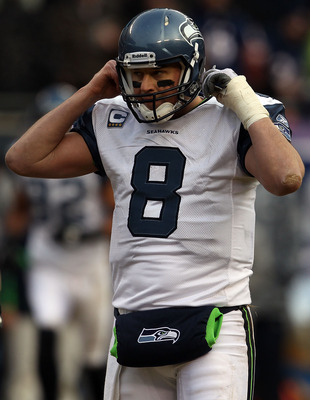 CHICAGO, IL - JANUARY 16:  Quarterback Matt Hasselbeck #8 of the Seattle Seahawks reacts while taking on the Chicago Bears in the 2011 NFC divisional playoff game at Soldier Field on January 16, 2011 in Chicago, Illinois.  (Photo by Jonathan Daniel/Getty