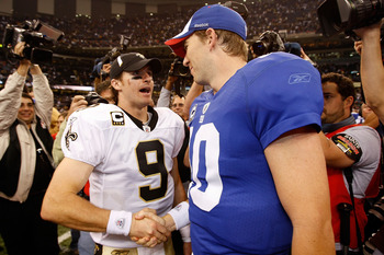 NEW ORLEANS - OCTOBER 18:  Drew Brees #9 of the New Orleans Saints is congratulated by Eli Manning #10 of the New York Giants after the Saints defeated the Giants 48-27  at the Louisiana Superdome on October 18, 2009 in New Orleans, Louisiana.  (Photo by