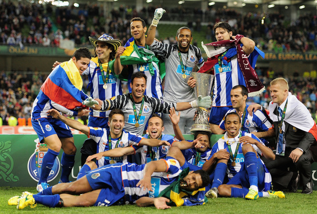 DUBLIN, IRELAND - MAY 18:  FC Porto players pose with the Europa league trophy during the UEFA Europa League Final between FC Porto and SC Braga at Dublin Arena on May 18, 2011 in Dublin, Ireland.  (Photo by Jamie McDonald/Getty Images)