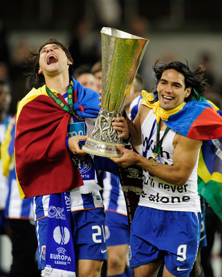 DUBLIN, IRELAND - MAY 18:  Cristian Sapunaru  and Radamel Falcao Garcia of FC Porto celebrate with the trophy during the UEFA Europa League Final between FC Porto and SC Braga at Dublin Arena on May 18, 2011 in Dublin, Ireland.  (Photo by Jamie McDonald/G