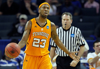CHARLOTTE, NC - MARCH 18:  Cameron Tatum #23 of the Tennessee Volunteers reacts after he is called for a travel in the second half while taking on the Michigan Wolverines during the second round of the 2011 NCAA men's basketball tournament at Time Warner