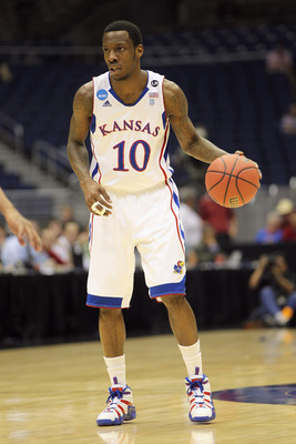 SAN ANTONIO, TX - MARCH 25:  Tyshawn Taylor #10 of the Kansas Jayhawks handles the ball against the Richmond Spiders during the southwest regional of the 2011 NCAA men's basketball tournament at the Alamodome on March 25, 2011 in San Antonio, Texas. Kansa
