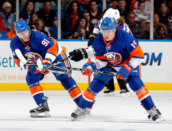UNIONDALE, NY - FEBRUARY 19:  John Tavares #91 and PA Parenteau #15 of the New York Islanders defend during an NHL hockey game against the Los Angeles Kings at the Nassau Coliseum on February 19, 2011 in Uniondale, New York.  (Photo by Paul Bereswill/Gett
