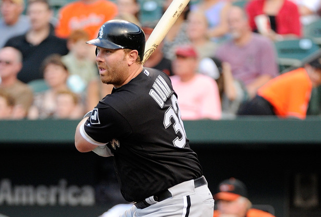 BALTIMORE, MD - AUGUST 08:  Adam Dunn #32 of the Chicago White Sox hits a single in the second inning against the Baltimore Orioles at Oriole Park at Camden Yards on August 8, 2011 in Baltimore, Maryland.  (Photo by Greg Fiume/Getty Images)