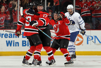 NEWARK, NJ - FEBRUARY 05:  Travis Zajac #19 of the New Jersey Devils celebrates his game tying goal in the third period against the Toronto Maple Leafs with teammtes Ilya Kovalchuk #17 and Zach Parise #9 at the Prudential Center on February 5, 2010 in New