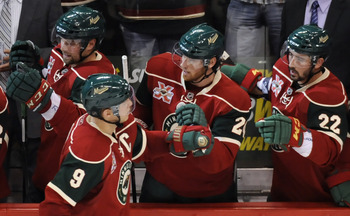ST PAUL, MN - OCTOBER 14: Mikko Koivu #9 of the Minnesota Wild celebrates with teammates on the bench a goal scored by Matt Cullen #7 in the third period during their game against the Edmonton Oilers on October 14, 2010 at Xcel Energy Center in St Paul, M