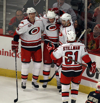 CHICAGO, IL - MARCH 04: (L-R) Bryan Allen #5, Eric Staal #12, Erik Cole #26 and Cory Stillman #61 of the Carolina Hurricanes celebrate a 1st period goal by Staal against the Chicago Blackhawks at the United Center on March 4, 2011 in Chicago, Illinois. (P