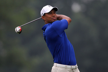 AKRON, OH - AUGUST 06:  Tiger Woods hits his tee shot on the third hole during the third round of the World Golf Championships-Bridgestone Invitational on the South Course at Firestone Country Club on August 6, 2011 in Akron, Ohio.  (Photo by Andy Lyons/G