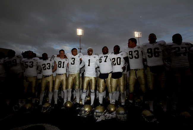 EL PASO, TX - DECEMBER 30:  The Notre Dame Fighting Irish celebrate a 33-17 win against the Miami Hurricanes at Sun Bowl on December 30, 2010 in El Paso, Texas.  (Photo by Ronald Martinez/Getty Images)