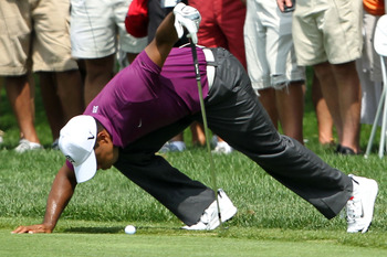 AKRON, OH - AUGUST 04:  Tiger Woods prepares to hit an approach shot on the fourth hole during the first round of the World Golf Championships-Bridgestone Invitational on the South Course at Firestone Country Club on August 4, 2011 in Akron, Ohio.  (Photo
