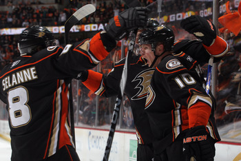 ANAHEIM, CA - APRIL 15:  Corey Perry (R) #10 of the Anaheim Ducks celebrates a goal with Teemu Selanne #8 in the first period against the Nashville Predators in Game Two of the Western Conference Quarterfinals during the 2011 NHL Stanley Cup Playoffs at H