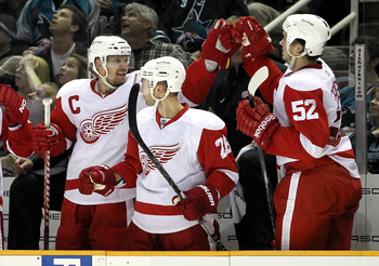SAN JOSE, CA - MAY 08:  Nicklas Lidstrom #5 and Jonathan Ericsson #52 of the Detroit Red Wings celebrate after the Red Wings scored a goal against the San Jose Sharks in Game Five of the Western Conference Semifinals during the 2011 NHL Stanley Cup Playof