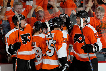 PHILADELPHIA - MAY 24:  Arron Asham #45 of the Philadelphia Flyers celebrates with Chris Pronger #20, Matt Carle #25, Claude Giroux #28 and James van Riemsdyk #21 after scoring a goal in the second period against the Montreal Canadiens in Game 5 of the Ea