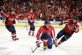 WASHINGTON, DC - MAY 01:  Alex Ovechkin #8 of the Washington Capitals celebrates with Brooks Laich #21, Alexander Semin #28, and Nicklas Backstrom #19 after scoring the tying goal in the third period against the Tampa Bay Lightning during Game Two of the