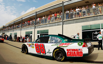 INDIANAPOLIS, IN - JULY 30:  Dale Earnhardt Jr. drives the #88 Amp Energy/National Guard Chevrolet through the garage area during practice for the NASCAR Sprint Cup Series Brickyard 400 at Indianapolis Motor Speedway on July 30, 2011 in Indianapolis, Indi
