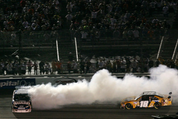 RICHMOND, VA - MAY 03: Dale Earnhardt Jr., driver of the #88 AMP Energy/National Guard Chevrolet, spins out of control after colliding with Kyle Busch, driver of the #18 Pedigree Toyota, during the NASCAR Sprint Cup Series Crown Royal Presents the Dan Low