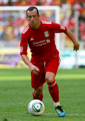 KUALA LUMPUR, MALAYSIA - JULY 16: Charlie Adam of Liverpool in action during the pre-season friendly match between Malaysia and Liverpool at the Bukit Jalil National Stadium on July 16, 2011 in Kuala Lumpur, Malaysia. (Photo by Stanley Chou/Getty Images)
